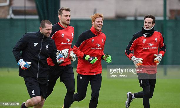 Simon Mignolet Adam Bogdan and Danny Ward of Liverpool during a training session at Melwood Training Ground on March 4 2016 in Liverpool England