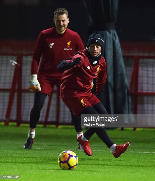 Simon Mignolet and Alex OxladeChamberlain of Liverpool during a training session at Melwood Training Ground on November 23 2017 in Liverpool England