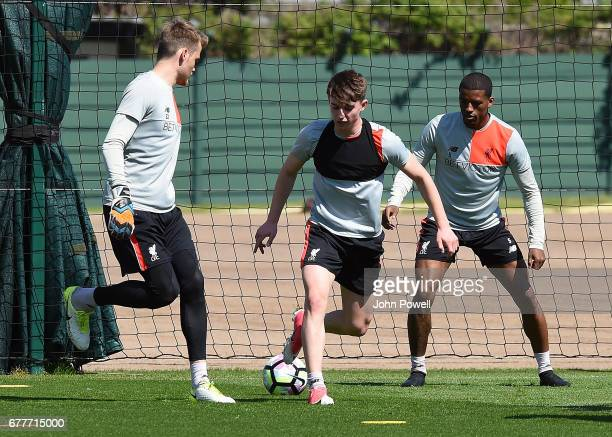 Simon Mignolet and Ben Woodburn of Liverpool during a training session at Melwood Training Ground on May 3 2017 in Liverpool England