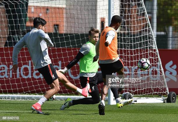 Simon Mignolet and Georginio Wijnaldum of Liverpool during a training session at Melwood Training Ground on May 10 2017 in Liverpool England