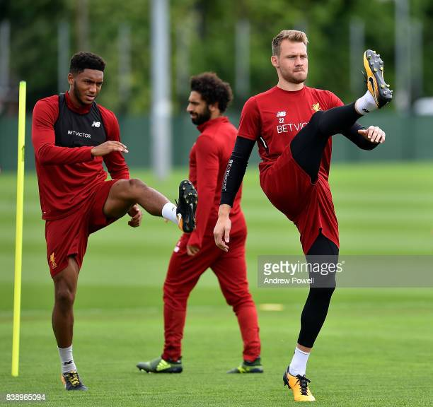 Simon Mignolet and Joe Gomez of Liverpool during a training session at Melwood Training Ground on August 25 2017 in Liverpool England