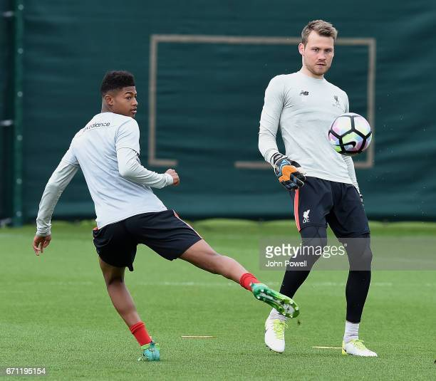 Simon Mignolet and Rhian Brewster of Liverpool during a training session at Melwood Training Ground on April 21 2017 in Liverpool England