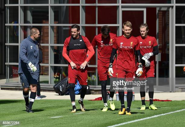 Simon Mignolet Danny Ward Loris Karius and Kamil Grabara of Liverpool with goal keeper coach John Achterberg during a training session at Melwood...