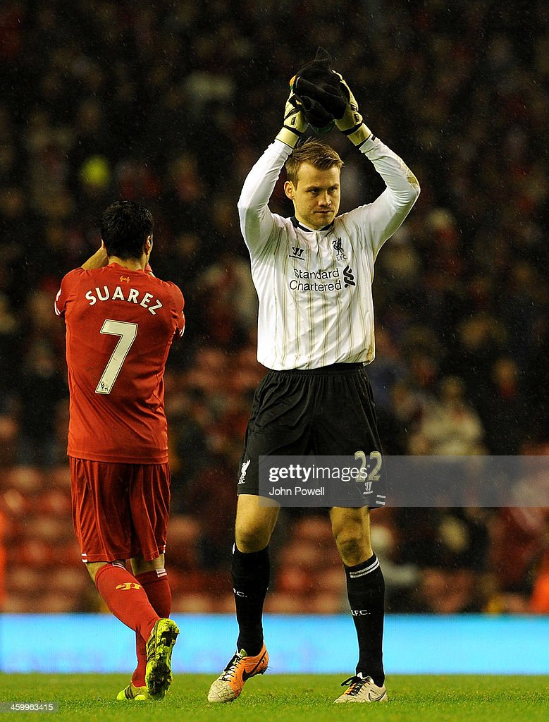 Simon Mignolet of Liverpool applauds the fans at the end of the Barclays Premier League match between Liverpool and Hull City at Anfield on January 1, 2014 in Liverpool, England.