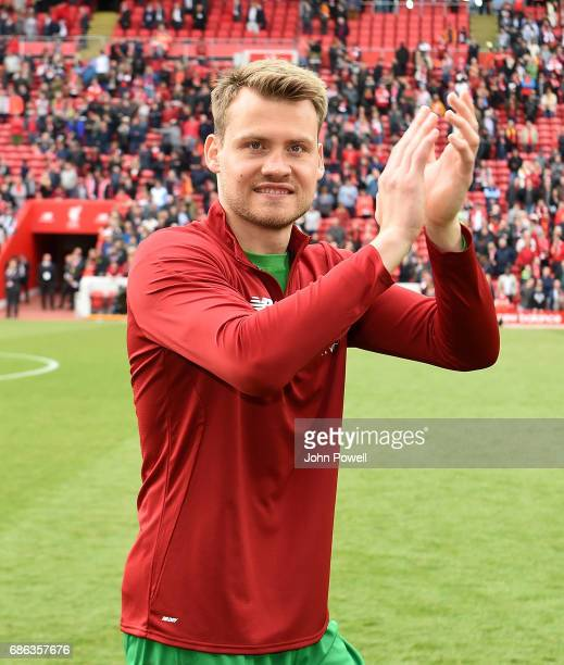 Simon Mignolet of Liverpool celebrates at the end of the Premier League match between Liverpool FC and Middlesbrough FC at Anfield on May 21 2017 in...