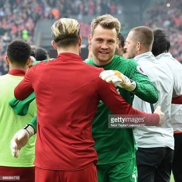 Simon Mignolet of Liverpool celebrates at the end of the Premier League match between Liverpool and Middlesbrough at Anfield on May 21 2017 in...