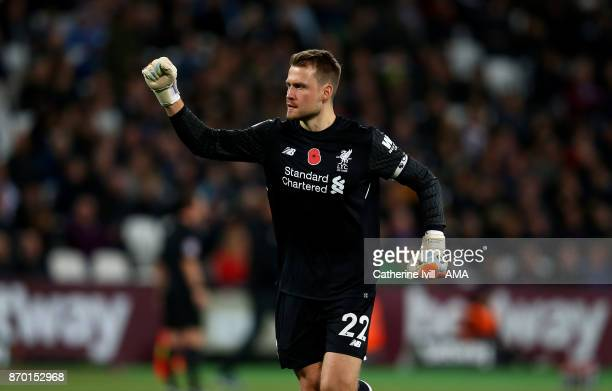 Simon Mignolet of Liverpool celebrates during the Premier League match between West Ham United and Liverpool at London Stadium on November 4 2017 in...