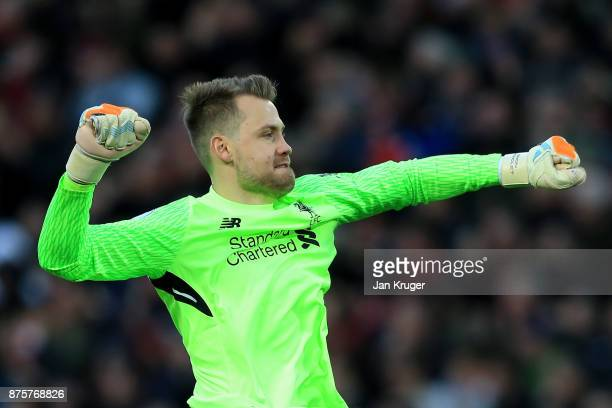 Simon Mignolet of Liverpool celebrates his side's opening goal during the Premier League match between Liverpool and Southampton at Anfield on...