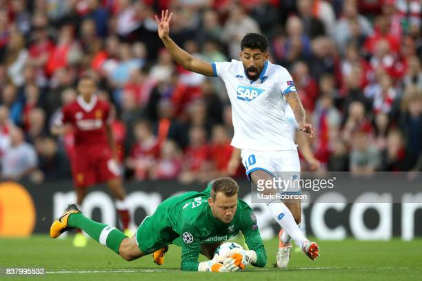 Simon Mignolet of Liverpool collects the ball from Kerem Demirbay of Hoffenheim during the UEFA Champions League Qualifying PlayOffs round second leg...