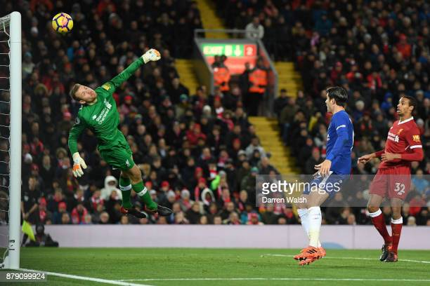 Simon Mignolet of Liverpool fails to stop Willian of Chelsea shot for Chelseas first goal during the Premier League match between Liverpool and...