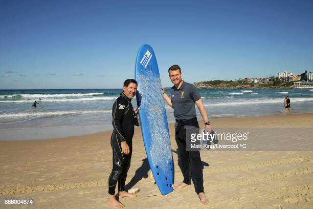 Simon Mignolet of Liverpool FC poses with a surfer during a Liverpool FC Fan Day at Bondi Beach on May 25 2017 in Sydney Australia