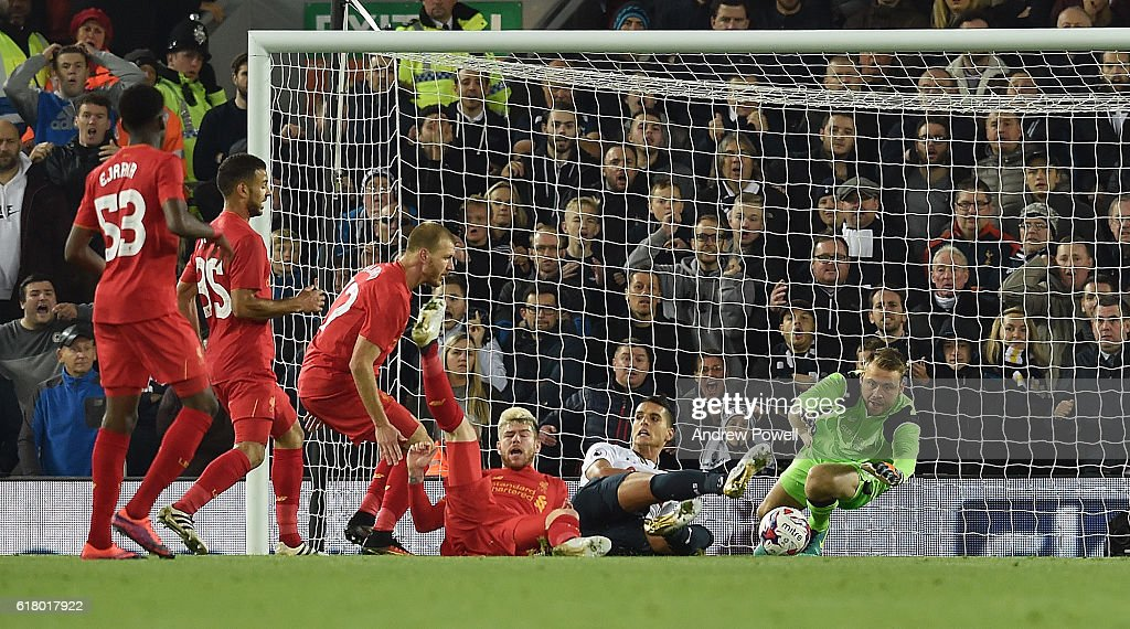 Simon Mignolet of Liverpool makes a save during the EFL Cup fourth round match between Liverpool and Tottenham Hotspur at Anfield on October 25, 2016 in Liverpool, England.