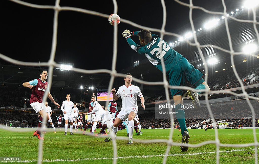 <a gi-track='captionPersonalityLinkClicked' href=/galleries/search?phrase=Simon+Mignolet&family=editorial&specificpeople=7124442 ng-click='$event.stopPropagation()'>Simon Mignolet</a> of Liverpool makes a save during the Emirates FA Cup Fourth Round Replay match between West Ham United and Liverpool at Boleyn Ground on February 9, 2016 in London, England.