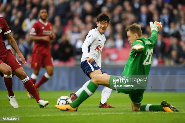 Simon Mignolet of Liverpool saves from HeungMin Son of Tottenham Hotspur during the Premier League match between Tottenham Hotspur and Liverpool at...