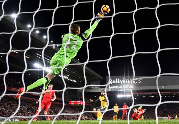 Simon Mignolet of Liverpool saves Olivier Giroud of Arsenal header during the Premier League match between Liverpool and Arsenal at Anfield on March...