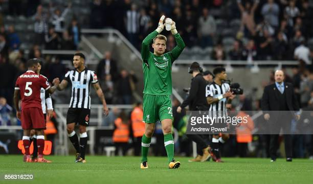 Simon Mignolet of Liverpool shows his appreciation to the fans at the end of the Premier League match between Newcastle United and Liverpool at St...