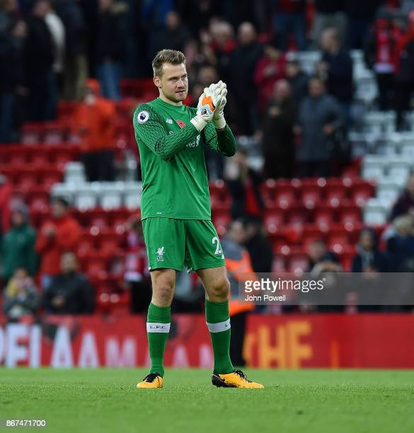 Simon Mignolet of Liverpool shows his appreciation to the fans at the end of the Premier League match between Liverpool and Huddersfield Town at...
