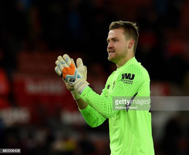 Simon Mignolet of Liverpool shows his appreciation to the fans at the end of the Premier League match between Stoke City and Liverpool at Bet365...