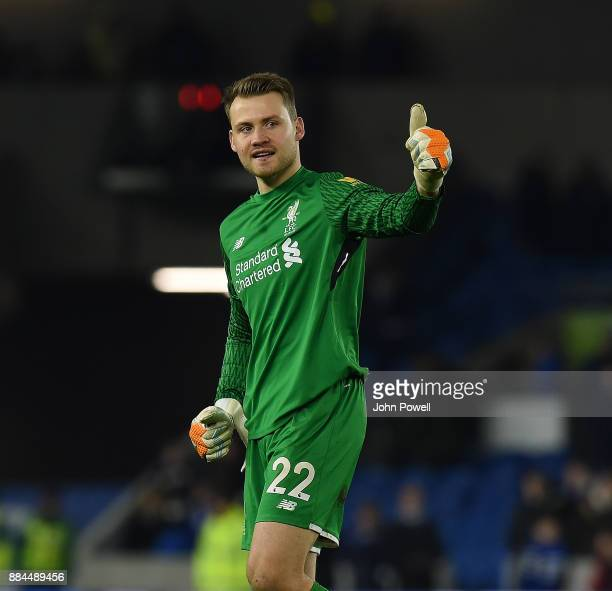Simon Mignolet of Liverpool shows his appreciation to the fans at the end of the Premier League match between Brighton and Hove Albion and Liverpool...