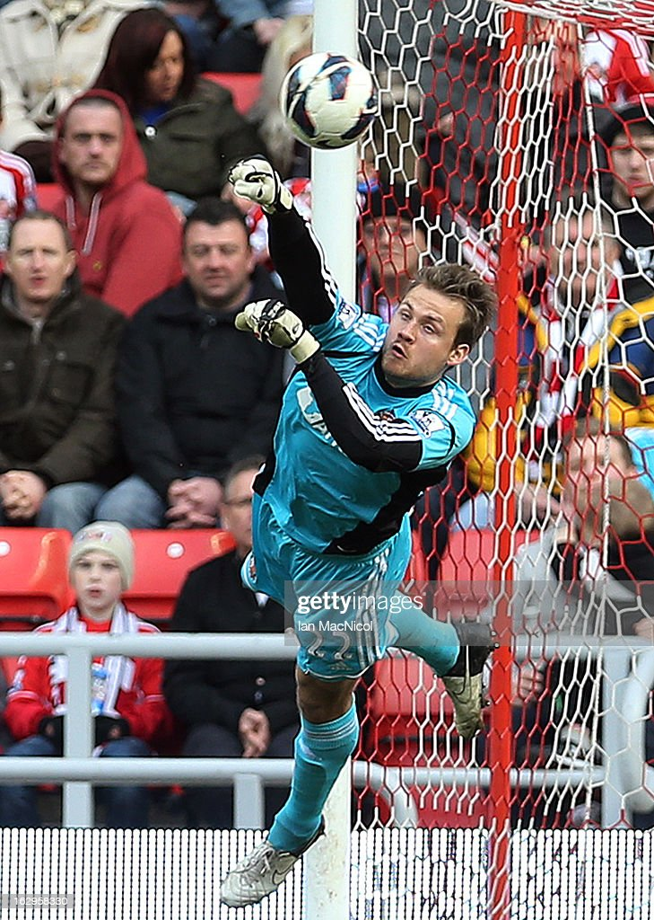 Simon Mignolet of Sunderland punches away a shot on goal during the Barclays Premier League match between Sunderland and Fulham at the Stadium of Light on March 02, 2013 in Sunderland, England.