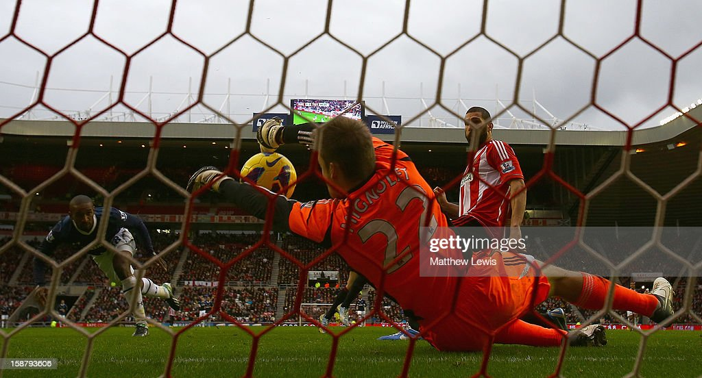 Simon Mignolet of Sunderland saves a shot from Jermaine Defo of Tottenham during the Barclays Premier League match between Sunderland and Tottenham Hotspur at Stadium of Light on December 29, 2012 in Sunderland, England.