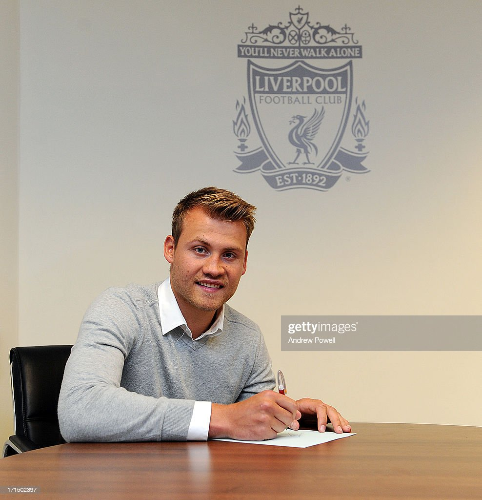 (MINIMUM FEES APPLY - GBP 150 FOR PRINT USE, GBP 75 ONLINE OR LOCAL EQUIVALENT, PER IMAGE) <a gi-track='captionPersonalityLinkClicked' href=/galleries/search?phrase=Simon+Mignolet&family=editorial&specificpeople=7124442 ng-click='$event.stopPropagation()'>Simon Mignolet</a> signs for Liverpool FC at Anfield on June 25, 2013 in Liverpool, England.