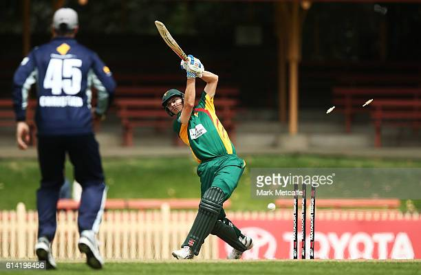 Simon Milenko of the Tigers is bowled by Marcus Stoinis of the Bushrangers during the Matador BBQs One Day Cup match between Victoria and Tasmania at...