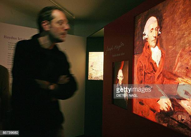 Simon Morgan This file picture shows visitors walking pass a portrait of Austrian composer Joseph Haydn during the opening of an exhibition 'Haydn´s...