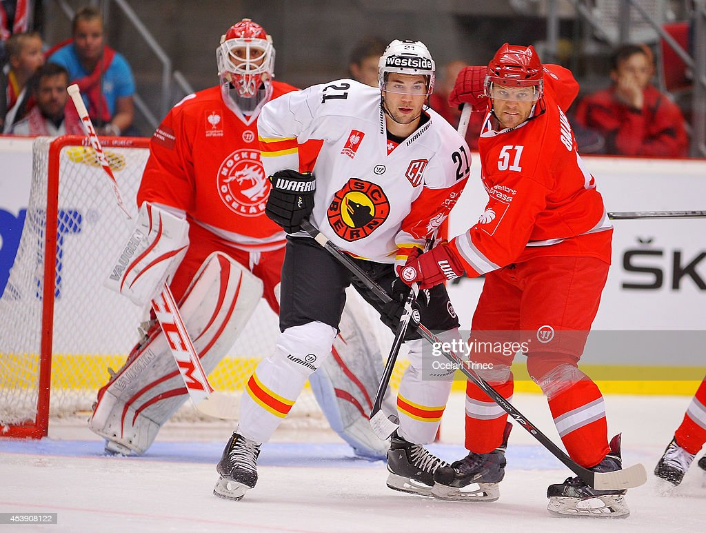 <a gi-track='captionPersonalityLinkClicked' href=/galleries/search?phrase=Simon+Moser&family=editorial&specificpeople=7727793 ng-click='$event.stopPropagation()'>Simon Moser</a> of SC Bern and Lukas Galvas of HC Ocelari Trinec tangle during the Champions Hockey League group stage game between HC Ocelari Trinec and SC Bern on August 21, 2014, Trinec, Czech Republic.