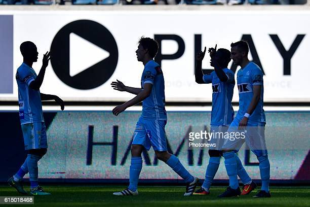 Simon Moses forward of KAA Gent celebrates scoring a goal with teammates during the Jupiler Pro League match between KAA Gent and SV Zulte Waregem in...