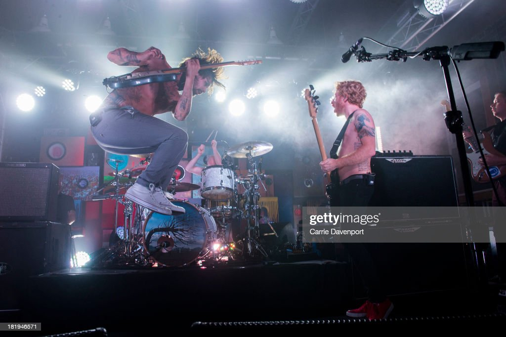 <a gi-track='captionPersonalityLinkClicked' href=/galleries/search?phrase=Simon+Neil&family=editorial&specificpeople=714520 ng-click='$event.stopPropagation()'>Simon Neil</a> and Ben Johnston of Biffy Clyro perform at Laverys as part of the fifth annual Arthur's Day celebrations on September 26, 2013 in Belfast, United Kingdom. Arthur's Day sees fans come together to experience live music and cultural events in over 500 pubs around Ireland. This year Arthur's Day will spread beyond music to support, promote and showcase Ireland's innovators, artists, poets, writers and culinary experts. It promises to be an extraordinary night, featuring performances from hundreds of home grown acts, rising stars and other internationally renowned artists such as, The Script, James Vincent McMorrow, The Original Rudeboys, Girl Band, Bouts, Le Galaxie, Ham Sandwich, Daley, Manic Street Preachers, Emeli Sande, Janelle Monae, Biffy Clyro, Kodaline, Iggy Azalea and the legendary Bobby Womack. For more information visit www.guinness.com or www.facebook.com/Guinnessireland
