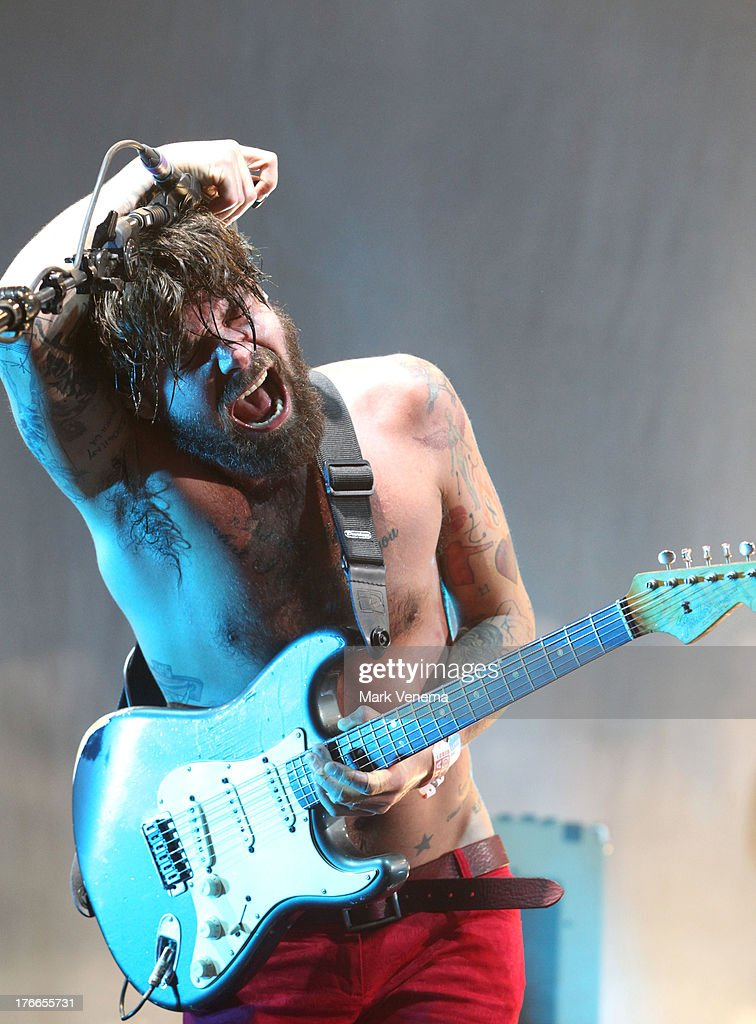 <a gi-track='captionPersonalityLinkClicked' href=/galleries/search?phrase=Simon+Neil&family=editorial&specificpeople=714520 ng-click='$event.stopPropagation()'>Simon Neil</a> of Biffy Clyro performs at day 1 of the Lowlands Festival on August 16, 2013 in Biddinghuizen, Netherlands.