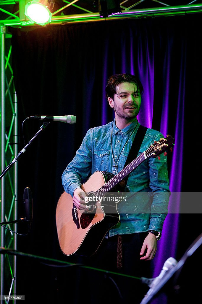 <a gi-track='captionPersonalityLinkClicked' href=/galleries/search?phrase=Simon+Neil&family=editorial&specificpeople=714520 ng-click='$event.stopPropagation()'>Simon Neil</a> of Biffy Clyro performs at the 104.5 iHeart Performance Theater on February 5, 2013 in Bala Cynwyd, Pennsylvania.