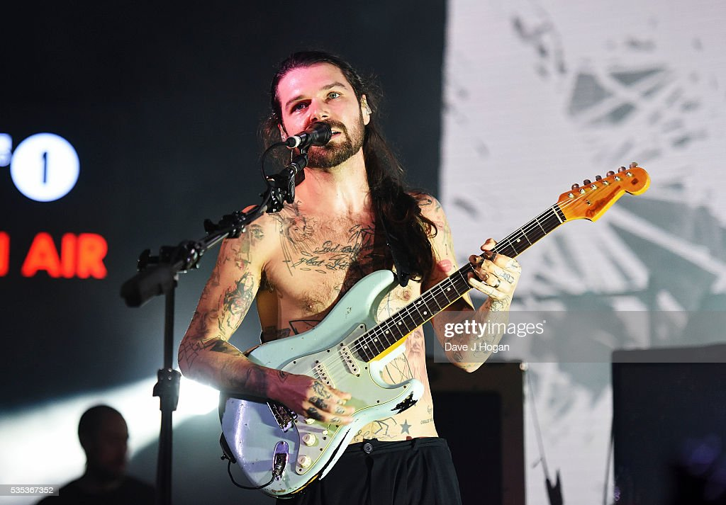 <a gi-track='captionPersonalityLinkClicked' href=/galleries/search?phrase=Simon+Neil&family=editorial&specificpeople=714520 ng-click='$event.stopPropagation()'>Simon Neil</a> of Biffy Clyro performs during day 2 of BBC Radio 1's Big Weekend at Powderham Castle on May 29, 2016 in Exeter, England.
