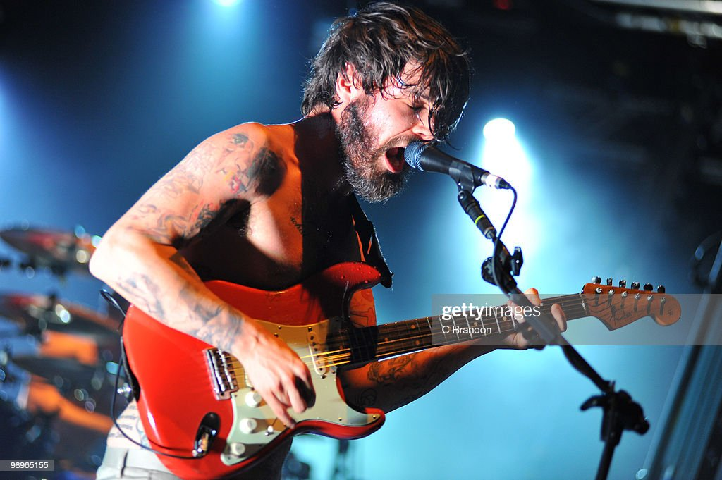Simon Neil of Biffy Clyro performs on stage at Hammersmith Apollo on May 6, 2010 in London, England.