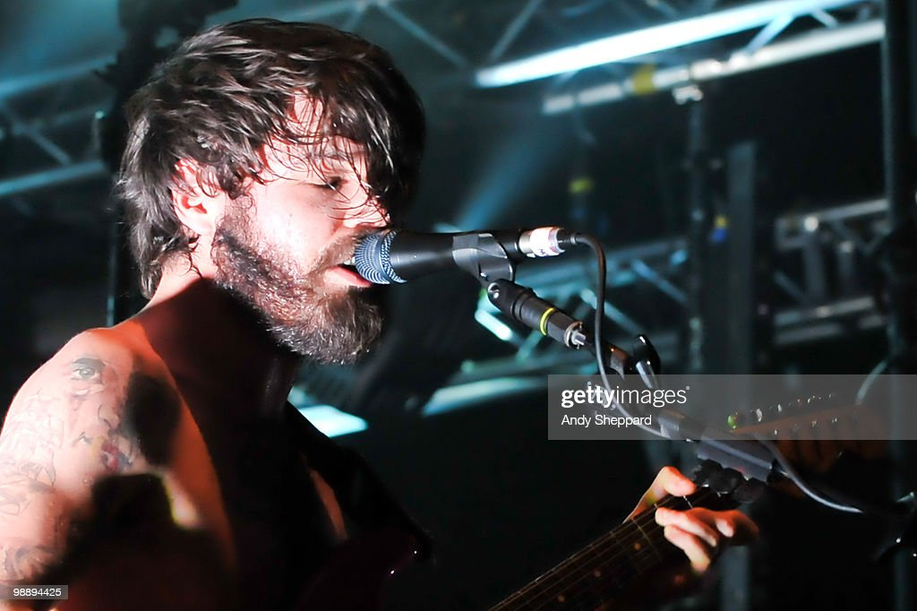 Simon Neil of Scottish rock band Biffy Clyro performs on stage at HMV Hammersmith Apollo on May 6, 2010 in London, England.