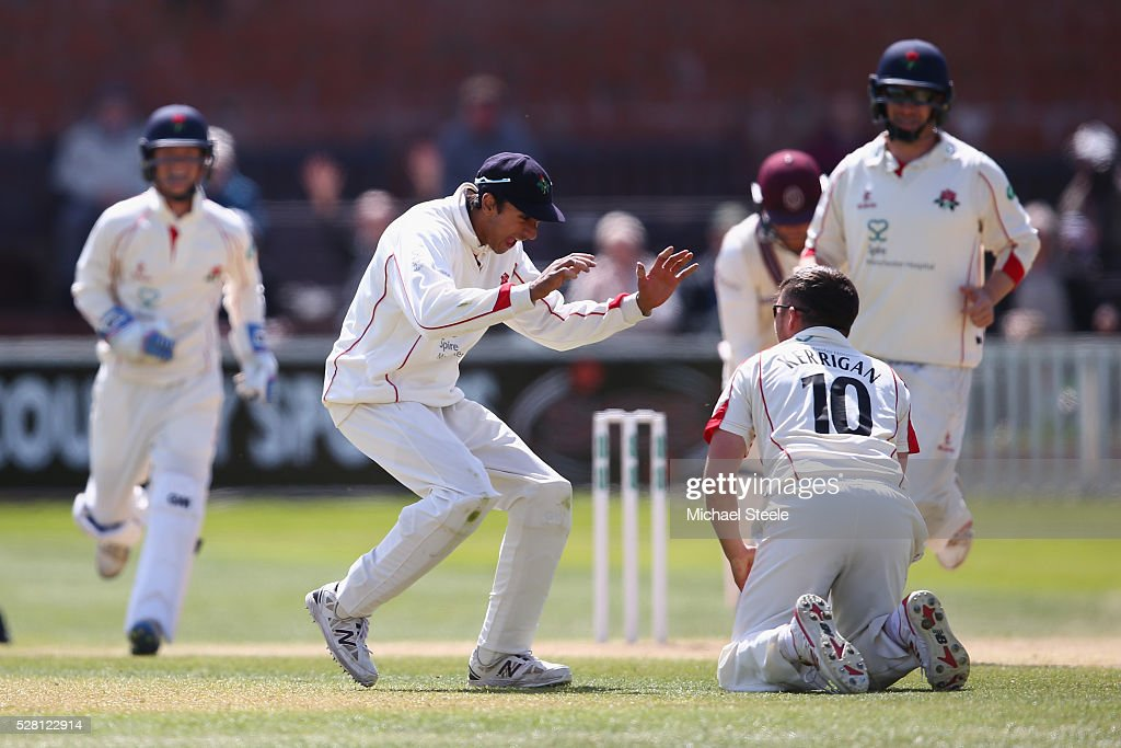 Simon (R) of Lancashire celebrates with Haseeb Hameed after taking a catch off his own bowling to claim the wicket of Tom Abell of Somerset during day four of the Specsavers County Championship Division One match between Somerset and Lancashire at The Cooper Associates County Ground on May 4, 2016 in Somerset, United Kingdom.