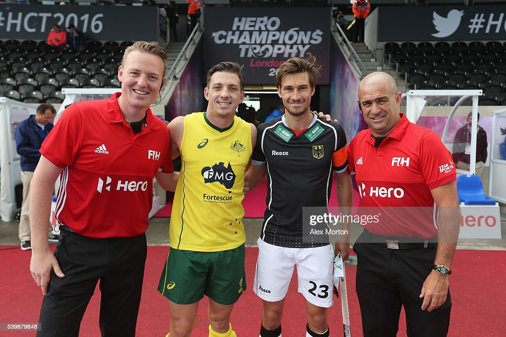 <a gi-track='captionPersonalityLinkClicked' href=/galleries/search?phrase=Simon+Orchard&family=editorial&specificpeople=4115447 ng-click='$event.stopPropagation()'>Simon Orchard</a> of Australia and Tobias Fuchs of Germany with match officials prior to the FIH Mens Hero Hockey Champions Trophy match between Germany and Australia at Queen Elizabeth Olympic Park on June 13, 2016 in London, England.