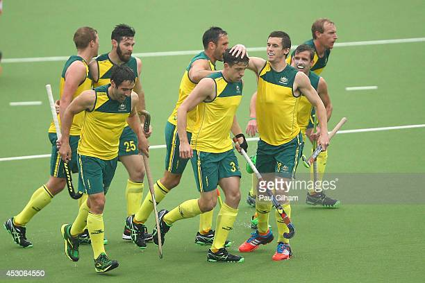 Simon Orchard of Australia celebrates with his teammates after scoring a goal for Australia in the Men's SemiFinal match between Australia and...