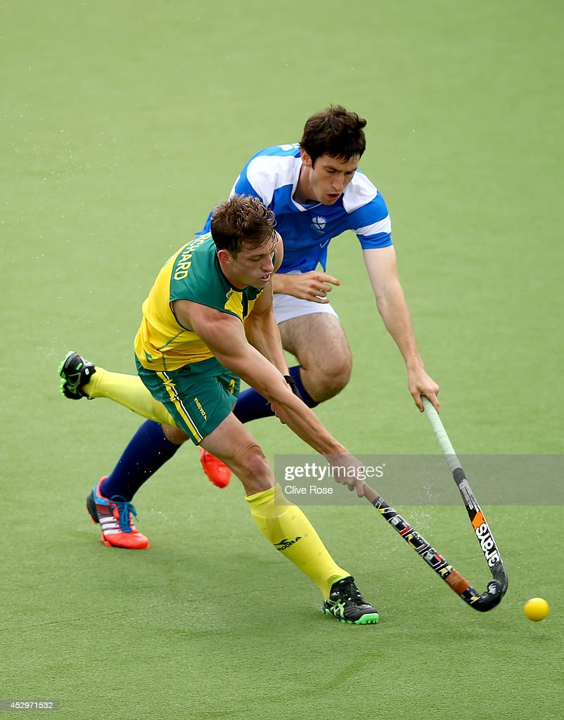 <a gi-track='captionPersonalityLinkClicked' href=/galleries/search?phrase=Simon+Orchard&family=editorial&specificpeople=4115447 ng-click='$event.stopPropagation()'>Simon Orchard</a> of Australia is challenged by Nicholas Parkes of Scotland during the men's preliminaries pool match between Australia and Scotland at the Glasgow National Hockey Centre during day eight of the Glasgow 2014 Commonwealth Games on July 31, 2014 in Glasgow, United Kingdom.