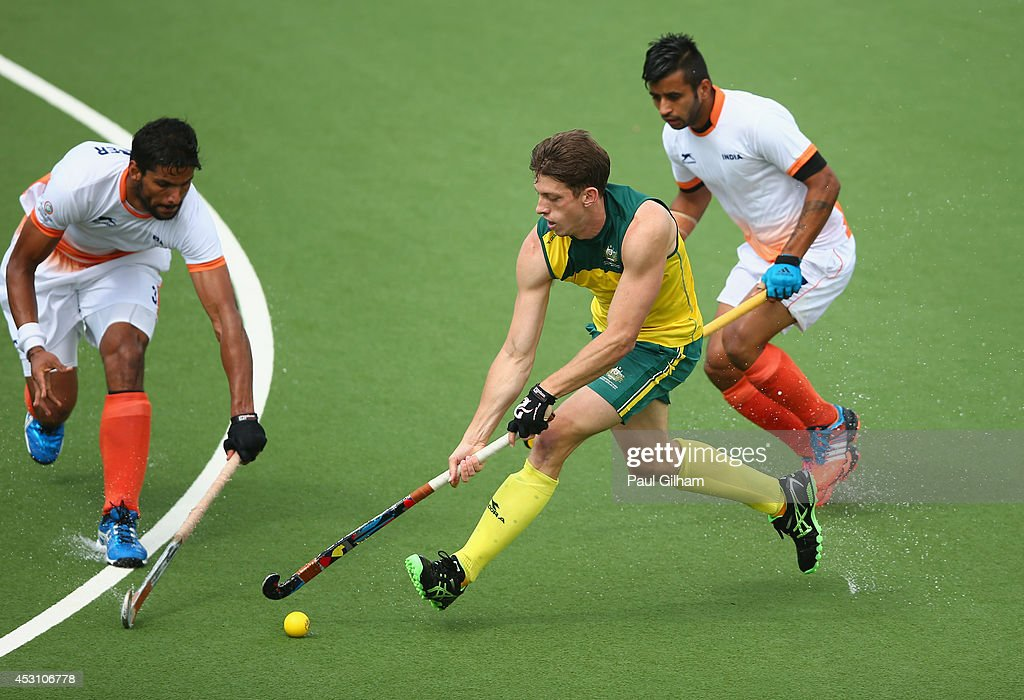 <a gi-track='captionPersonalityLinkClicked' href=/galleries/search?phrase=Simon+Orchard&family=editorial&specificpeople=4115447 ng-click='$event.stopPropagation()'>Simon Orchard</a> of Australia prepare battles for the ball with <a gi-track='captionPersonalityLinkClicked' href=/galleries/search?phrase=Manpreet+Singh+-+Field+Hockey+Player&family=editorial&specificpeople=16029378 ng-click='$event.stopPropagation()'>Manpreet Singh</a> of India during the Men's Gold Medal Match Final between India and Australia at Glasgow National Hockey Centre during day eleven of the Glasgow 2014 Commonwealth Games on August 3, 2014 in Glasgow, United Kingdom.