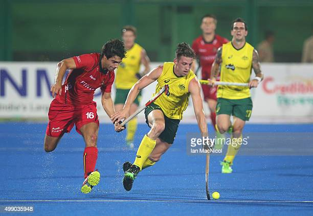 Simon Orchard of Australia runs with the ball during the match between Australia and Belgium on day two of The Hero Hockey League World Final at the...