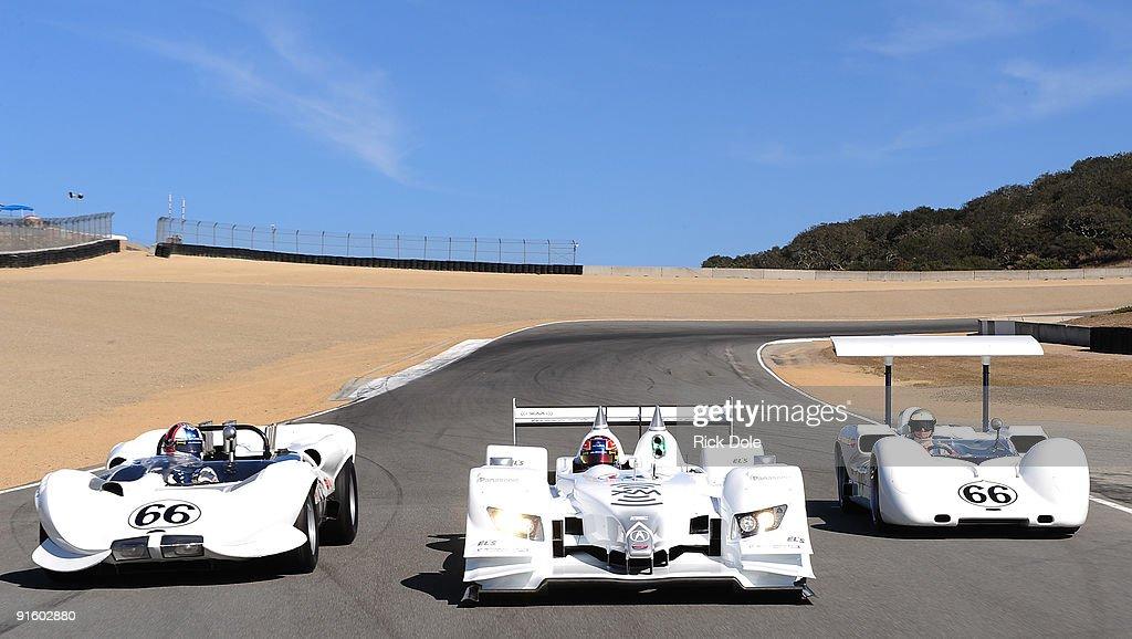 Simon Pagenaud drives the de Ferran Motorsports Acura ARX02a Gil de Ferran drives the Chaparral 2 Can Am car and the Jim Hall drives the Chaparral 2E...