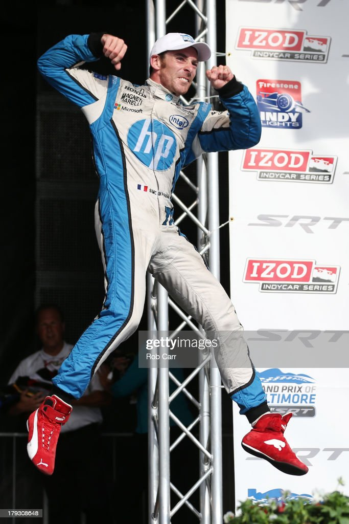 <a gi-track='captionPersonalityLinkClicked' href=/galleries/search?phrase=Simon+Pagenaud&family=editorial&specificpeople=4184388 ng-click='$event.stopPropagation()'>Simon Pagenaud</a> of France, driver of the #77 Schmidt Hamilton Motorsports Honda Dallara, celebrates at the podium after winning the IZOD IndyCar Series Baltimore Grand Prix on September 1, 2013 in Baltimore, Maryland.