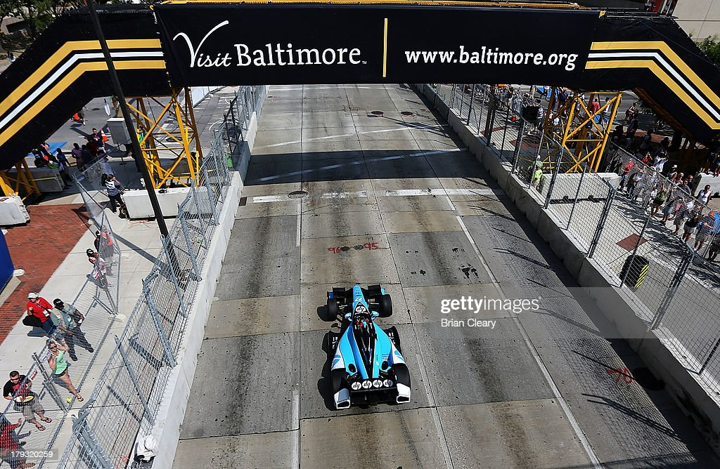 Simon Pagenaud, of France, driver of the #77 Schmidt Hamilton Motorsports Honda Dallara drives down the front stretch en route to winning the Grand Prix of Baltimore on September 1, 2013 in Baltimore, Maryland.