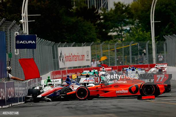 Simon Pagenaud of France driver of the Schmidt Peterson Hamilton Motorsports Dallara Honda and Takuma Sato of Japan driver of the AJ Foyt Enterprises...