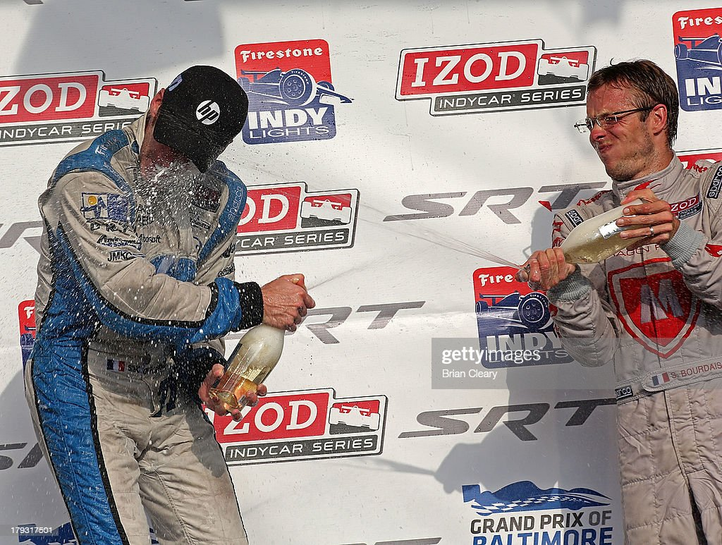 <a gi-track='captionPersonalityLinkClicked' href=/galleries/search?phrase=Simon+Pagenaud&family=editorial&specificpeople=4184388 ng-click='$event.stopPropagation()'>Simon Pagenaud</a>,L , of France, driver of the #77 Schmidt Hamilton Motorsports Honda Dallara is sprayed with champagne by <a gi-track='captionPersonalityLinkClicked' href=/galleries/search?phrase=Sebastien+Bourdais&family=editorial&specificpeople=178338 ng-click='$event.stopPropagation()'>Sebastien Bourdais</a>, of France, driver of the #7 Dragon Racing Chevrolet Dallara the after winning the Grand Prix of Baltimore on September 1, 2013 in Baltimore, Maryland.