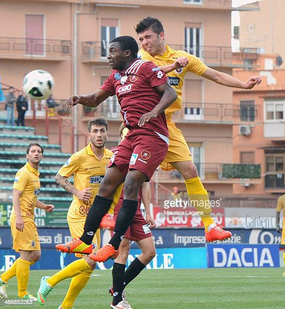 Simon Pambou of Reggina competes for the ballin air with Emanuele Busellato of Cittadella during the Serie B match between Reggina Calcio and AS...