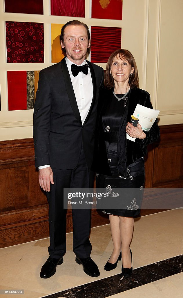 Simon Pegg (L) and mother Gillian arrive at the after party following the EE British Academy Film Awards at Grosvenor House on February 10, 2013 in London, England.
