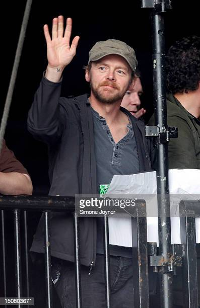 Simon Pegg is watches the Black Keys at the Main Stage on Day Three during the Reading Festival 2012 at Richfield Avenue on August 26 2012 in Reading...